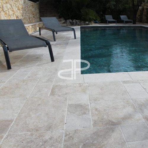 contour de piscine en travertin apex pierre